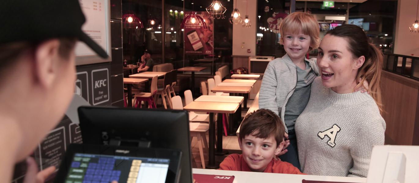 family at counter in restaurant